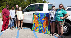 UA Marine Science Club donates recycled art to DISL